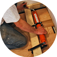 Small photo of Cepco Tool Quikjack working on  hardwood floor boards